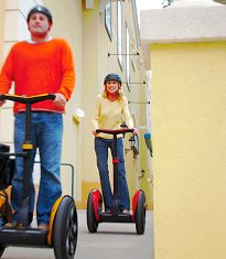 Two people riding their Segway HTs.